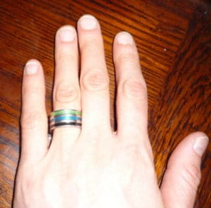 Paula's frugal engagement ring is clear plastic with three colored stripes