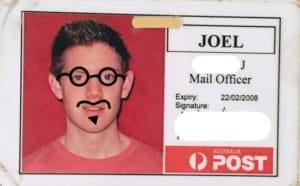 Joel's old work badge for the AU Post