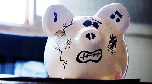 beat up broke piggy bank