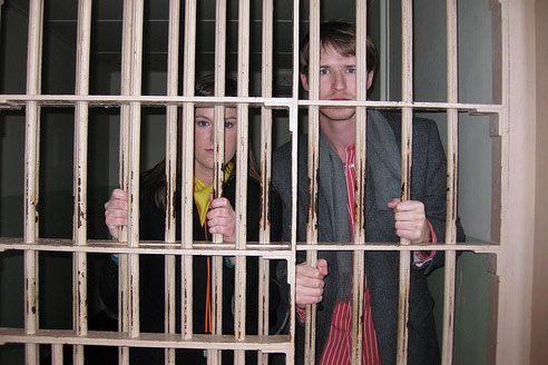 man & woman behind bars