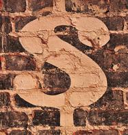 dollar sign on brick