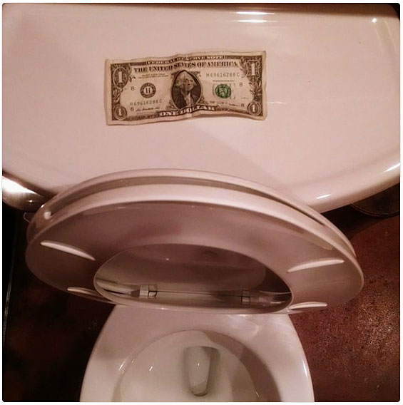 dollar bill toilet prank