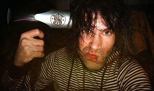 hair dryer gun to head