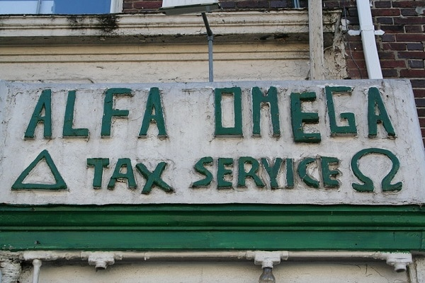 a storefront for a business called Alpha Omega Tax Service