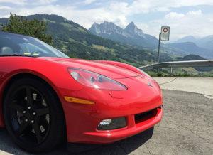 red convertible corvette scenery