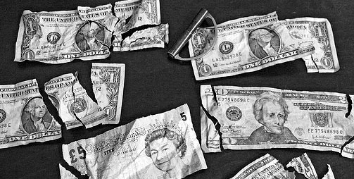 ripped up money