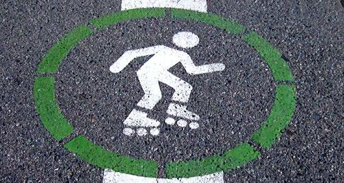 rollerblading man symbol