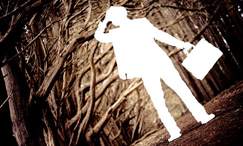 shadow man in woods with briefcase