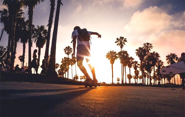 skateboarder in sunset