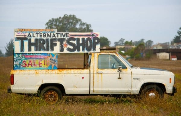 an old pickup truck has been turned into an alternative thrift shop