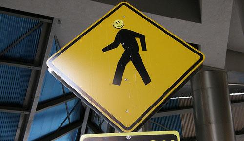walking smiley man sign