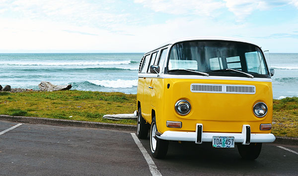 yellow vw bus at beach