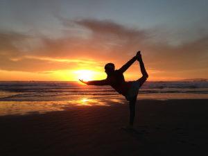 yoga posing sunset