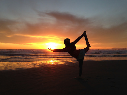 yoga posing sunset